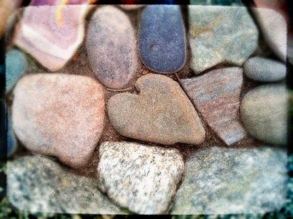 A found heart I captured among the rocks of my aunt's yard. Digitally altered photograph.