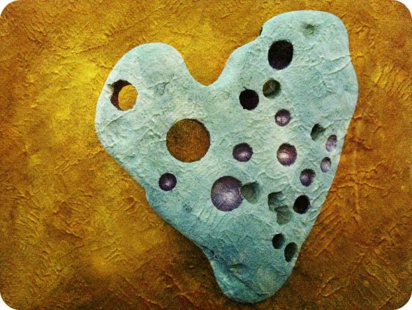 "Healing heart stone, ""Love Heals"" digitally altered image of hand-painted stone."